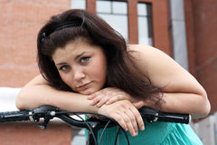 Girl and bike Royalty Free Stock Photography