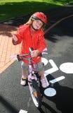 Girl and bike Stock Image