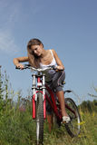 Girl on bike Stock Photography