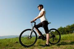 Girl on a bike. Offroad biker Royalty Free Stock Photo