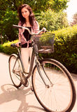 Girl with bike Royalty Free Stock Photo