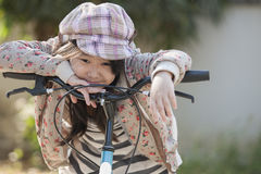 Girl and bike. Cute asian girls are happy with her bike Stock Image