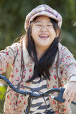 Girl and bike. Cute asian girls are happy with her bike Royalty Free Stock Photography