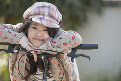 Girl and bike. Cute asian girls are happy with her bike royalty free stock image