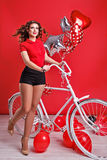 Girl with bike and balloons Stock Photo