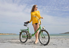 Girl with a bike Stock Photography