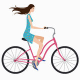 Girl on bike. Beautiful girl in dress rides a bicycle Stock Images