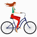 Girl on bike. Beautiful girl in sportswear rides a bicycle Stock Images