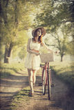 Girl with a bike Stock Image