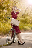 Girl with bike at countryside. Royalty Free Stock Images