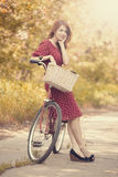 Girl with bike at countryside. Stock Photo