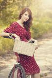 Girl with bike at countryside. Stock Photos