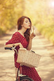 Girl with bike at countryside. Royalty Free Stock Image