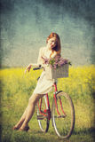 Girl with a bike Stock Images