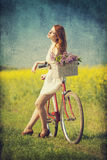 Girl with a bike Royalty Free Stock Images