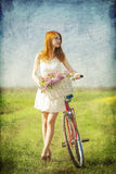 Girl with a bike Royalty Free Stock Photo