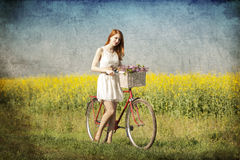 Girl with a bike Royalty Free Stock Photography