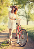 Girl on a bike Royalty Free Stock Image