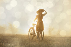 Girl on a bike in the countryside Royalty Free Stock Images