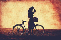 Girl on a bike Royalty Free Stock Images