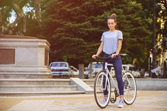 Girl with a bike fix. The girl with the bike fix, concept health, sports Royalty Free Stock Image