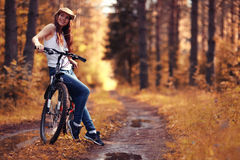 Girl on bike at forest Royalty Free Stock Images