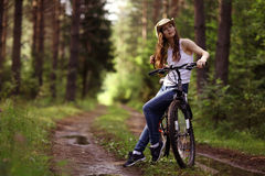 Girl on bike at forest Stock Photos