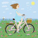 Girl on bike girl on bicycle on background of the sea Stock Photo