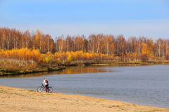 Girl with Bike on Lakeside Royalty Free Stock Photography