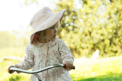 Girl on bike looking Royalty Free Stock Photos