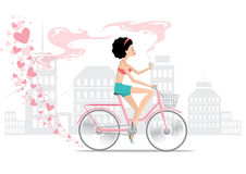 Girl on bike in love Stock Photo