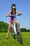 Girl with bike Royalty Free Stock Photography