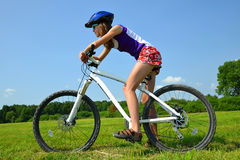 Girl on the bike. Portrait of a girl on the bike Royalty Free Stock Images