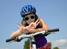 Girl on bike. Portrait of a girl on bike Royalty Free Stock Photo