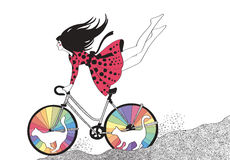 Girl on bike with rainbow cats Royalty Free Stock Images