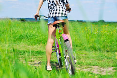 Girl on bike rare view Stock Images