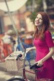 Girl with bike Stock Image