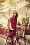 Girl with bike Stock Images