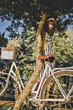 Girl on a bike ride with a retro hipster bike Stock Photos