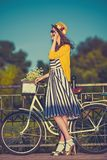 Girl on a bike ride with a retro hipster bike Stock Photography