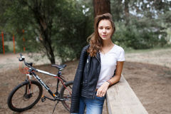 The girl on the bike ride in the woods on a mountain bike. Royalty Free Stock Photo