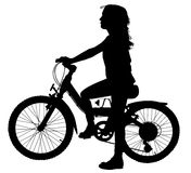 Girl on bike. Girl rides a bicycle on a walk Royalty Free Stock Photos