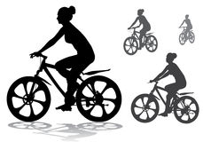 Girl on bike. Girl rides a bicycle on a walk Royalty Free Stock Image