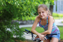 Girl with bike Stock Photos