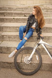 Girl with bike Royalty Free Stock Images