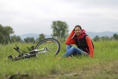 Girl on bike. Sport and recreation of people in the picturesque nature Royalty Free Stock Images