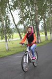 Girl on bike. Sport and recreation of people in the picturesque nature Royalty Free Stock Photos