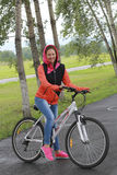 Girl on bike. Sport and recreation of people in the picturesque nature Stock Photo