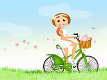 Girl on bike in spring Royalty Free Stock Photos