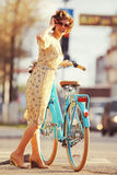 Girl with bike in  summer park Stock Images